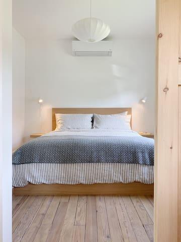 Minimalistic queen bedroom on ground floor