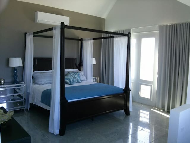 Room 1 with king bed and private bathroom