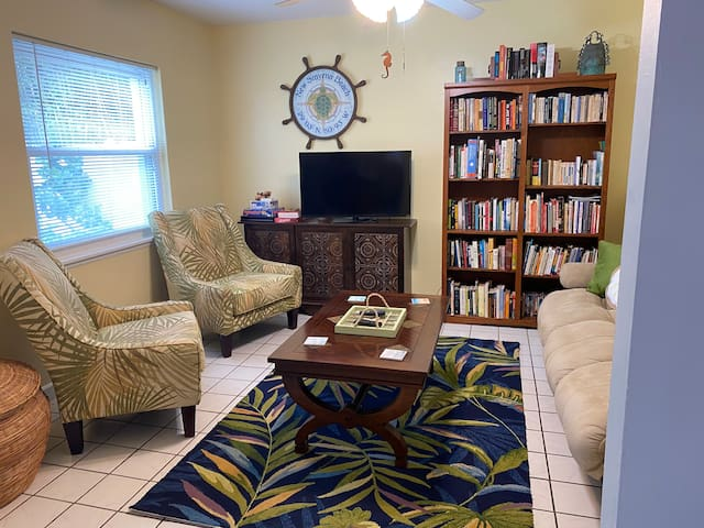 Your vacation retreat has a comfy living room with a smart TV, a broad selection of books, and board games.