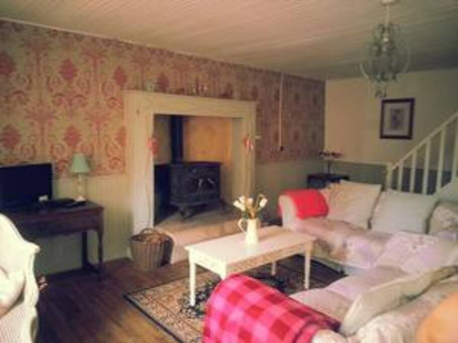 comfy lounge with woodburner