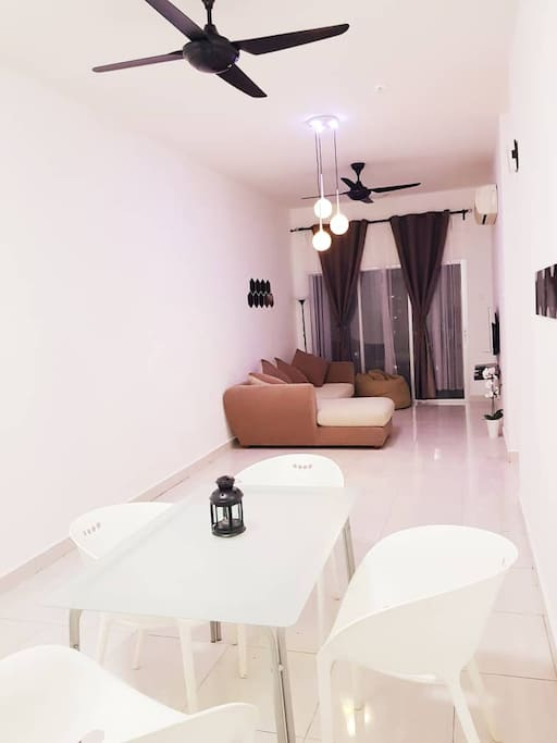 A perfect spacious living room to hangout with breezy wind by the balcony!