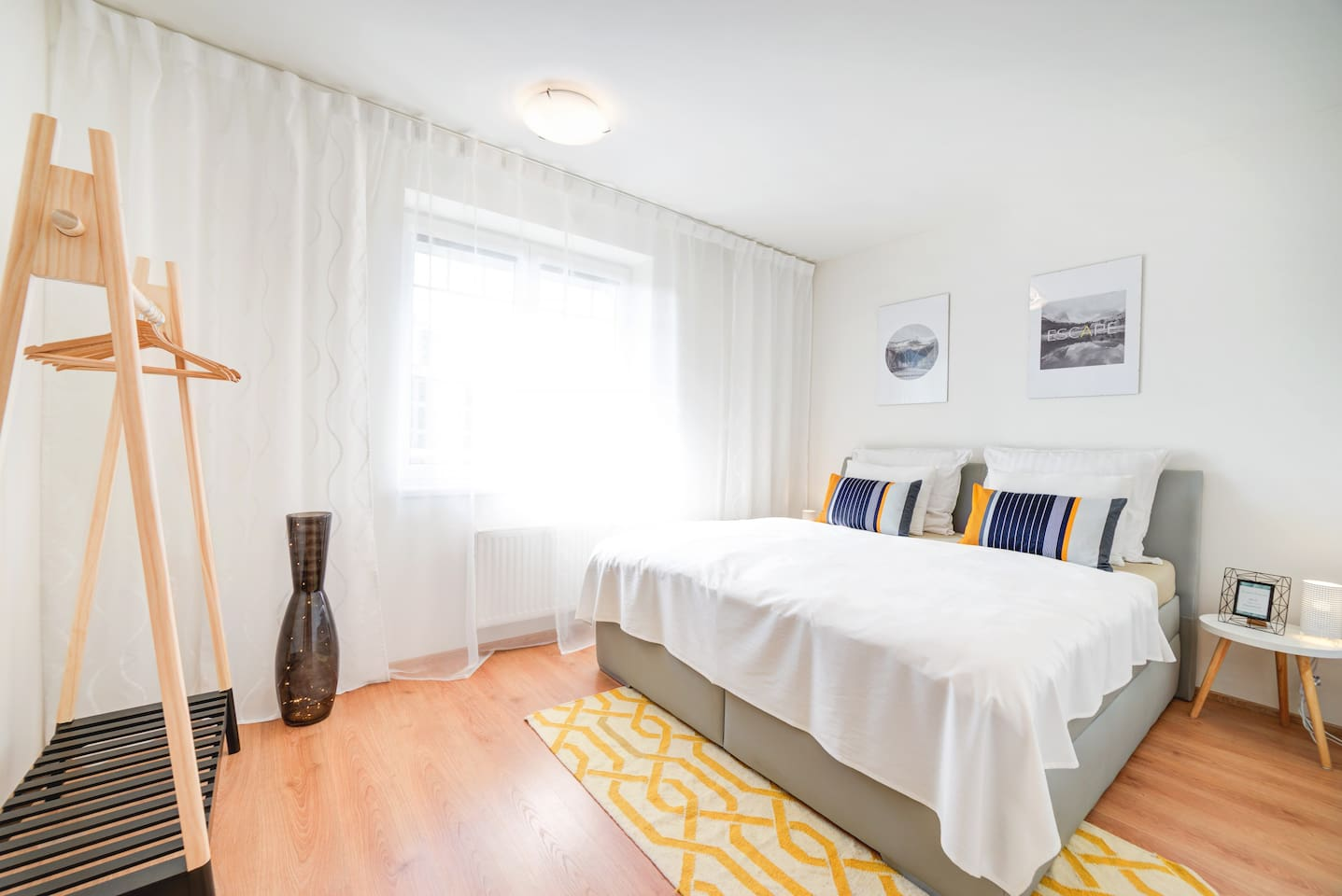 Relax on a large and comfortable bed after a wonderful day spent in Brno.