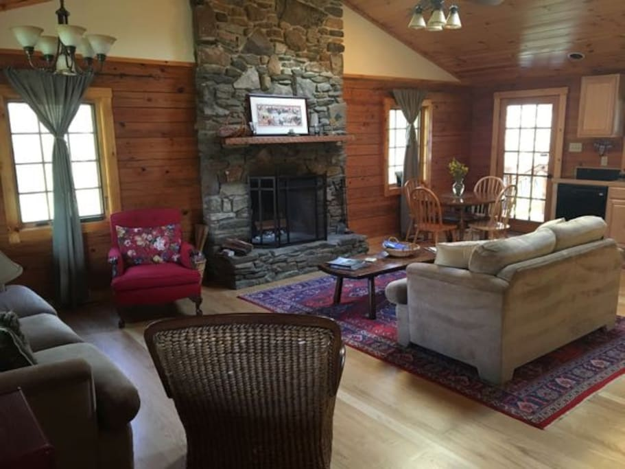 Living Dining Area with Fireplace.  Wood supplied.