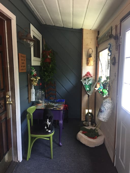 You will enter to our sun porch which is also residence to Corkie our cat.  She has free roam to come and go but can be closed out for a time if she gets too friendly.  It's a nice place to read and soak up the sunshine!