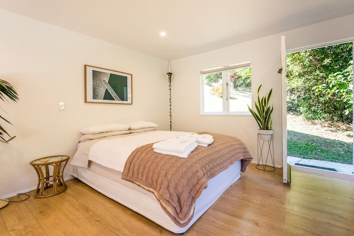 Bedroom 2  Comfortable Queen bed with Luxury bedding, spacious area in main lounge area