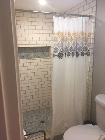 The custom shower features tile from Morocco.