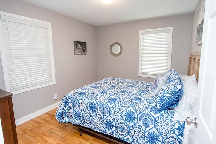 Peaceful bedroom in a quiet setting, profiling work of a local photographer.