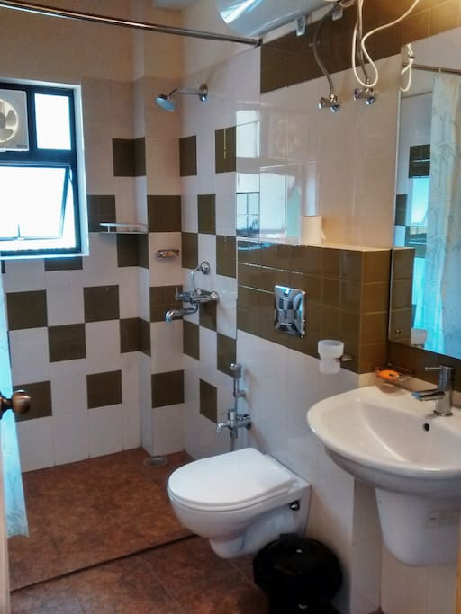 A modern bathroom with stylish, easy to handle fittings, western wc and 24 hrs hot and cold water.