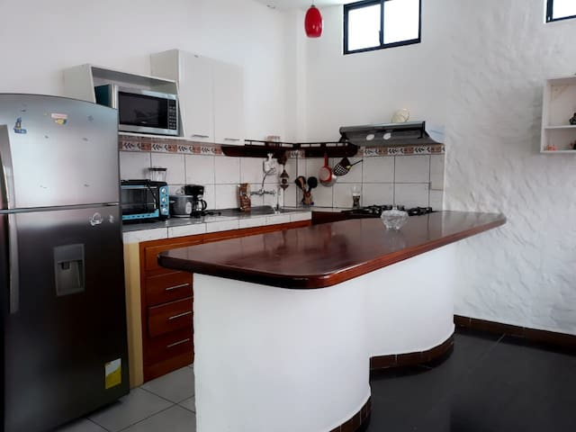 The apartment has a kitchen  all the cookware included. Make a sandwich or a coffee and enjoy The Enchanted Island