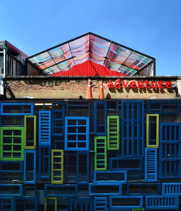 A chic design hostel with colorful facade