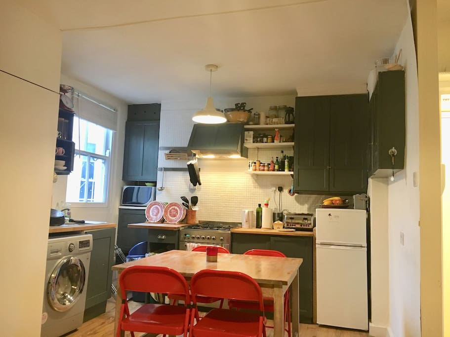 Our little kitchen, with extractor fan, oven, hobs and washer dryer!