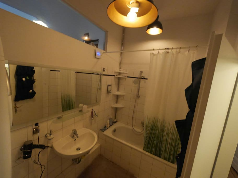 Bathroom Shower with large mirror and rustic carbon filament bulbs.
