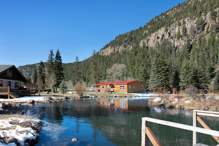 Spacious waterfront cabin w/hot tub, furnished deck & wood stove