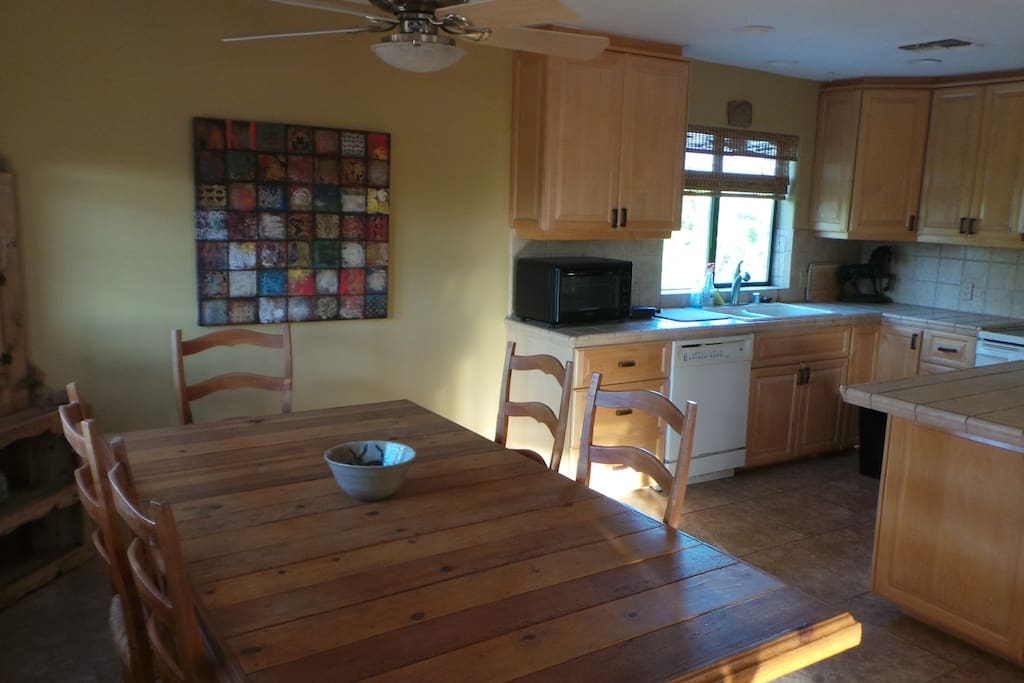 step into a large open area dining, kitchen and living area