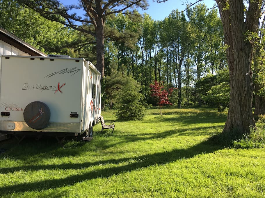 Our sweet camper is nestled in a beautiful quiet spot between the woods and open space that flanks Broadwater Creek on the Chesapeake Bay.
