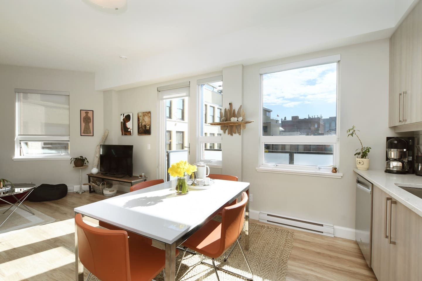 Gorgeous and sunny open concept space overlooking Victoria's historic Market Square.