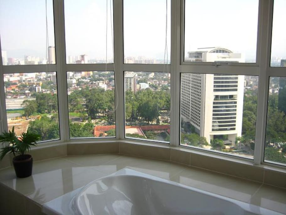 bathtub with view of KL