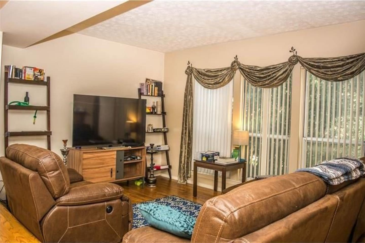 L shaped couch, love seat, TV with Netflix and Amazon Prime