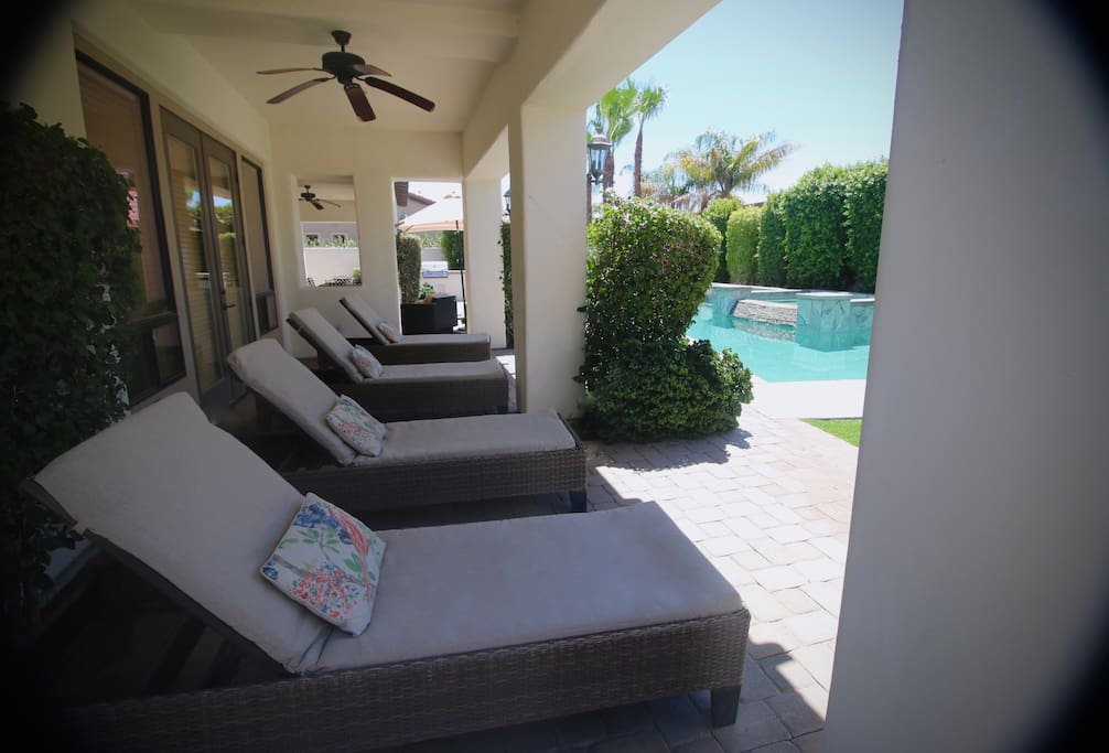 Shaded West Patio lounge area. Wheeled chaises can be pulled out for sunbathing.