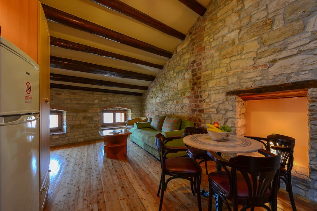 Living room in traditional Istrian style dominated by stone