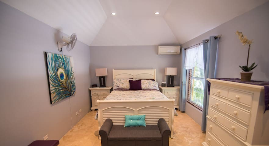 This lovely guest room has a walk-in closet and double vanity ensuite bathroom.