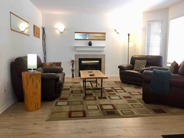 Living room is kept tidy, uncluttered and clean