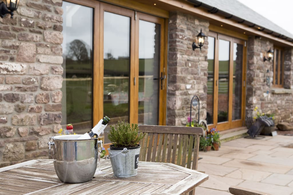 Dine Al fresco on the patio, overlooking rolling countryside