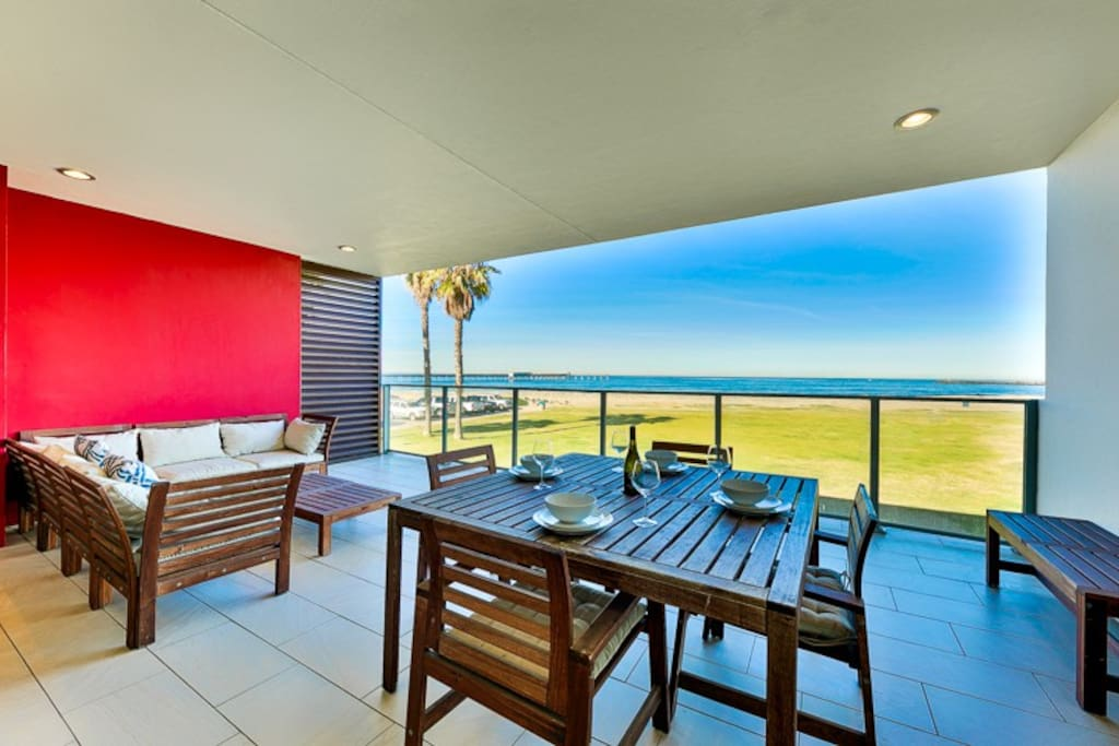 View of the beautiful blue Pacific from your very own living and dining room area.
