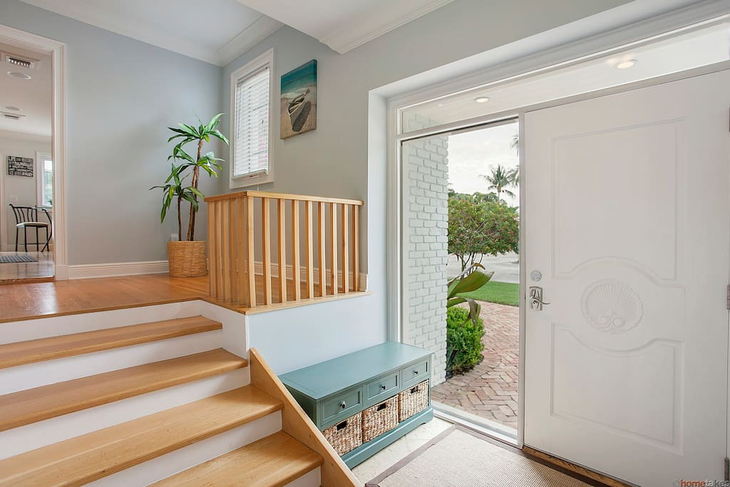 The large entrance way opens to both living upstairs and downstairs living rooms.