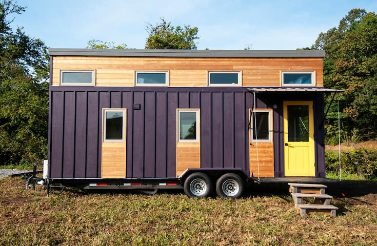 This modern tiny home is 24' long (roughly 250 square feet) with two open lofts.