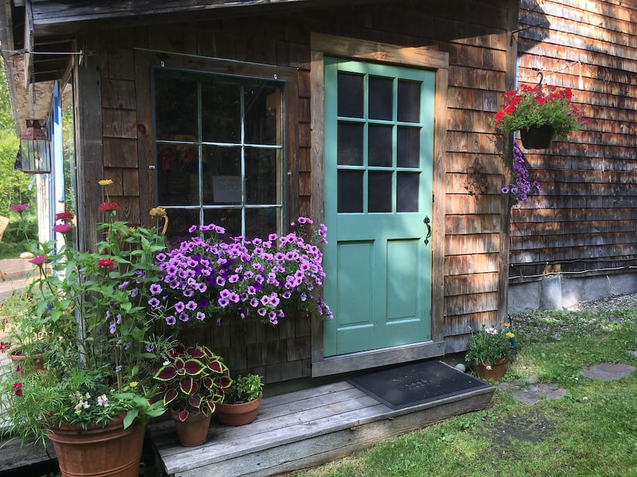 This is the door to mudroom where you can hang your towels in Summer, your sweaters in the Fall or your coats in Winter!