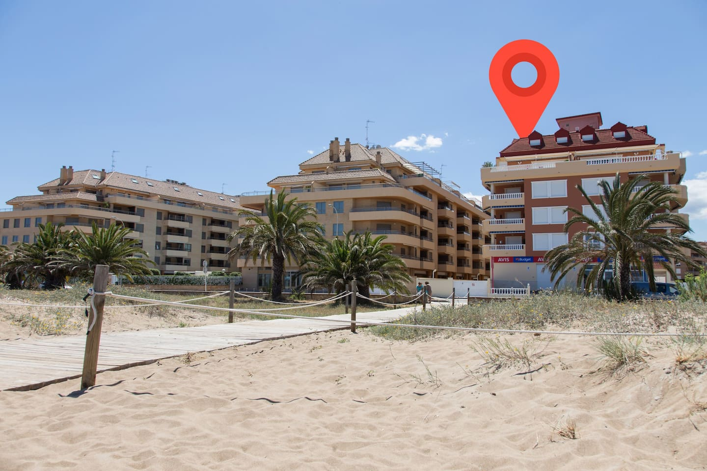 view of the apartment's facade from the beach