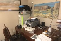 My home office is a bit messy but there are some original paintings