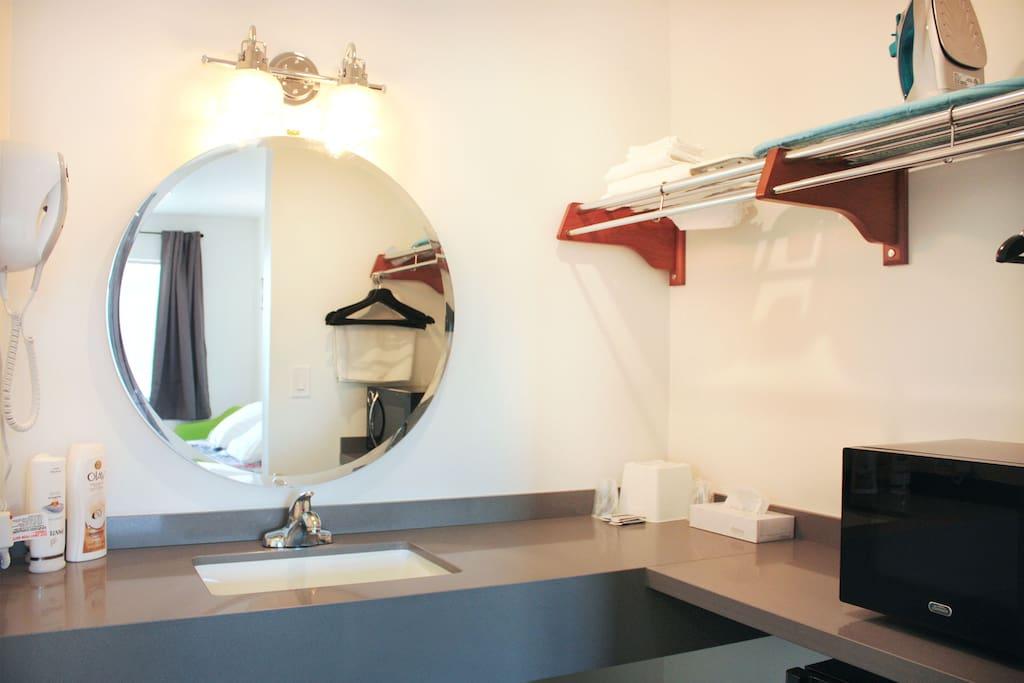 Sink Area w/ Hairdryer, Microwave, Fridge, Strorage