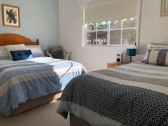 Double bed and single bed in one bedroom