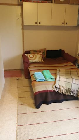 Own peaceful room with one bunk bed for two. Additional beds for 1-2 children available, also a baby bed. A working table, cupboard and shelves. Wifi and wired network without additional costs.