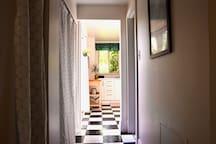 Hallway to kitchen with washer dryer