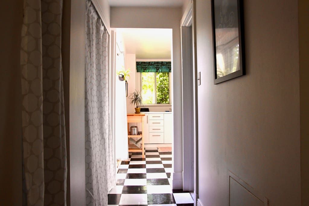Hallway to kitchen with washer dryer