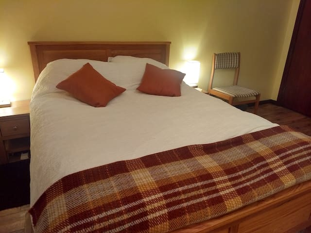 Solid oak bed with a high quality mattress, good pillows and luxurious bed linen.