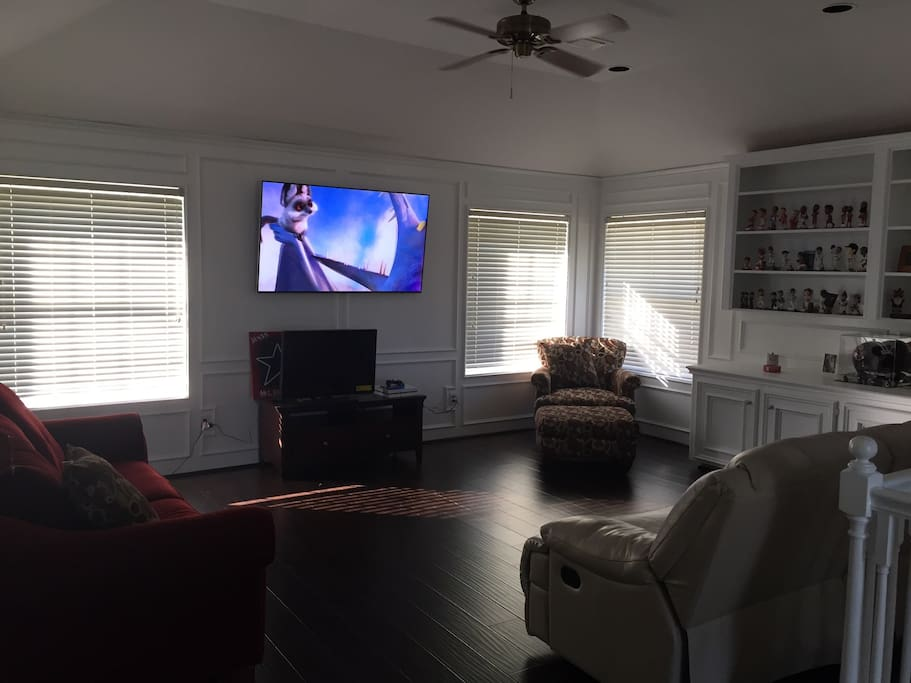 Relax in the upstairs game room. Two recliners and a pull out sofa bed for extra room!