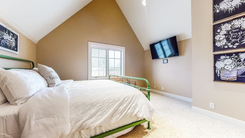 """The """"Barn view"""" bedroom might be the best room in the house. The 3rd floor views of the farm and The Barn are truly incredible. This room features a king bed, vaulted celings,  and 55"""" TV."""