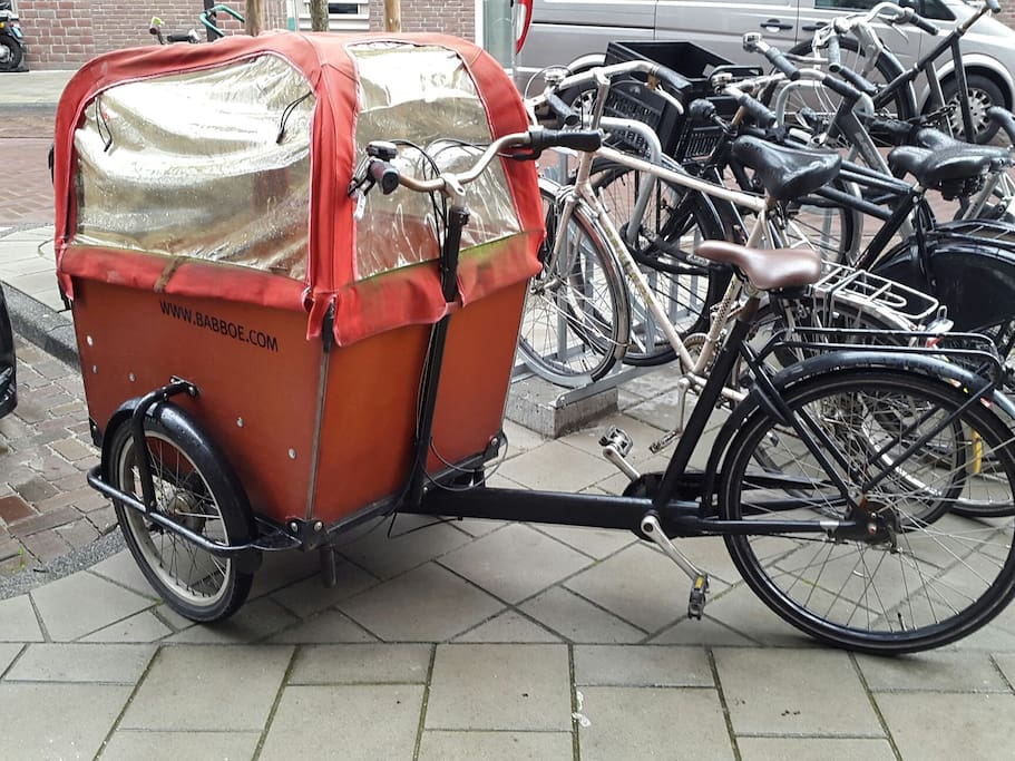 children's transport bike with rain cover (rain cover can be opened at 3 sides with sunny weather! ;)