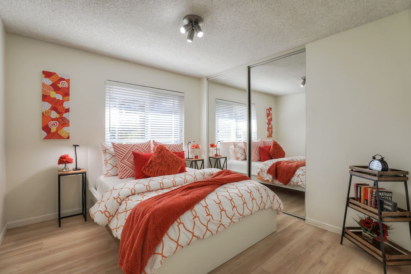 The second bedroom is bright and welcoming, with a queen size bed and large closet.