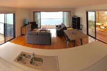 Kitchen view through lounge to end deck