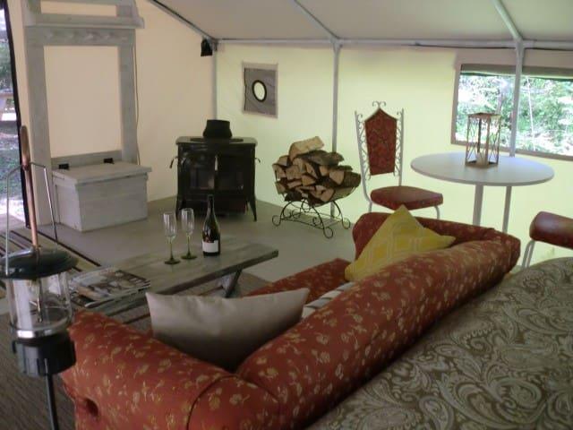 Heated Luxury Tent w/wood stove, river, lake.