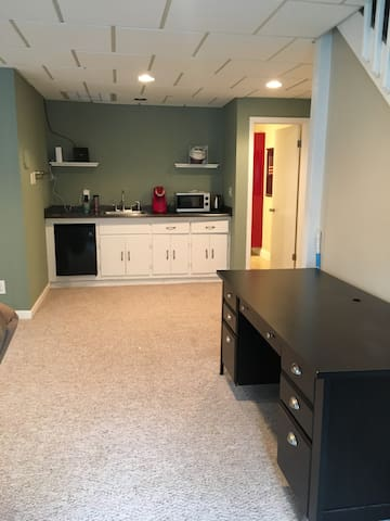 Looking at the desk and kitchenette