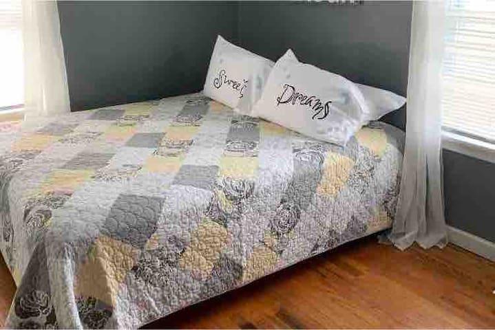 Queen size bed with hardwood floors