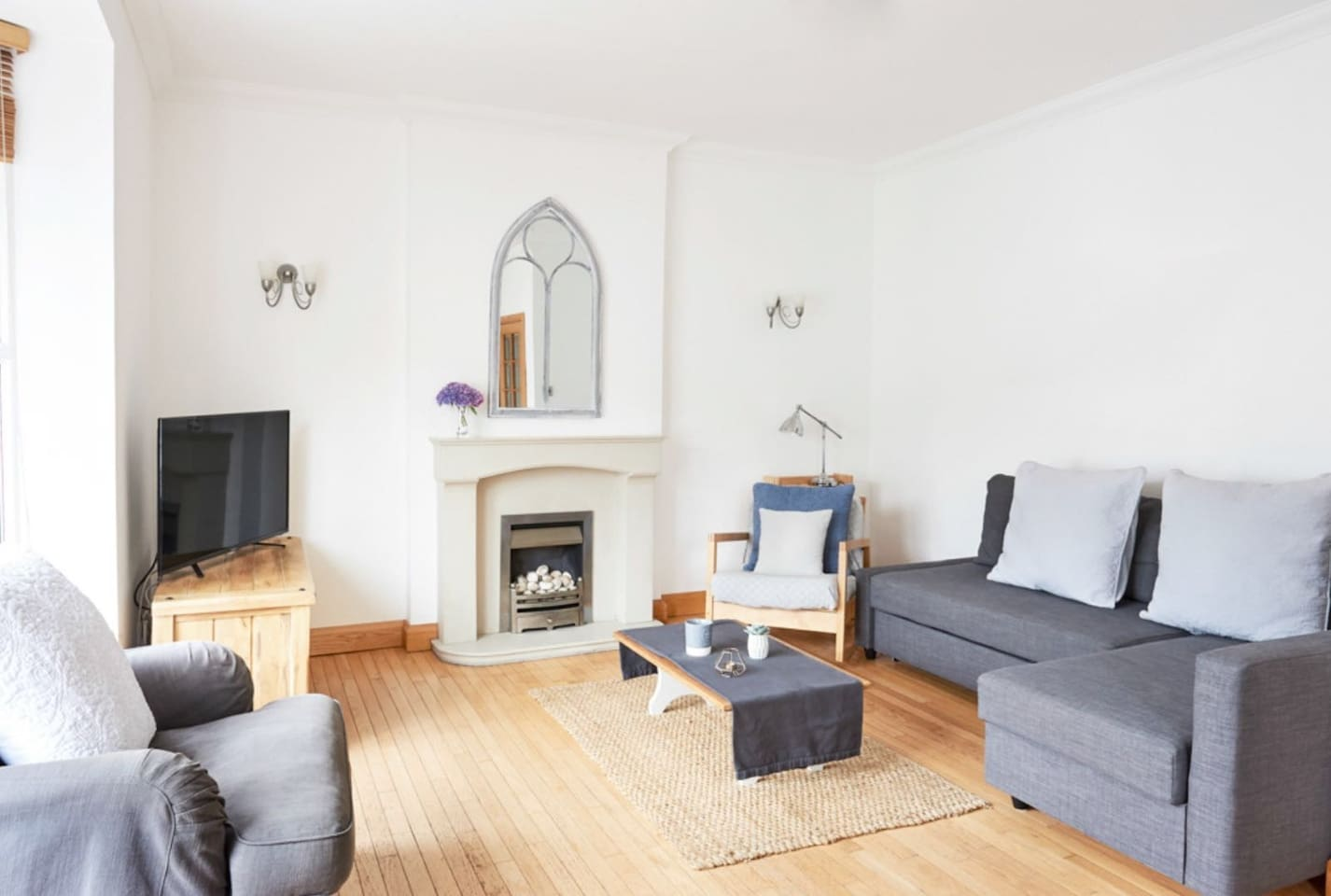 The comfortable, bright living room in Dudley House. The sofa bed pulls out to make an extra double bed.