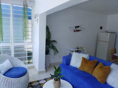 This is a 2 bedroom 2 baths apartment, one street from the beach and 3 minutes from Juan Dolio Beach. First floor, living room, full kitchen with gas stove, washer/dryer. Split ac in each bedroom and fans throughout the apartment. WiFi is also provid