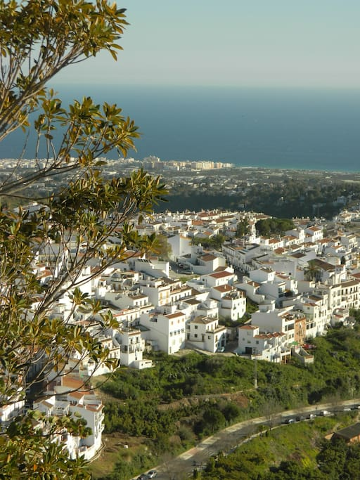 A view from the third tier of our three tiered garden behind the house. Pictured is the new part of the village of Frigiliana. You can also see in the distance the city of Nerja and the Mediterranean ocean.
